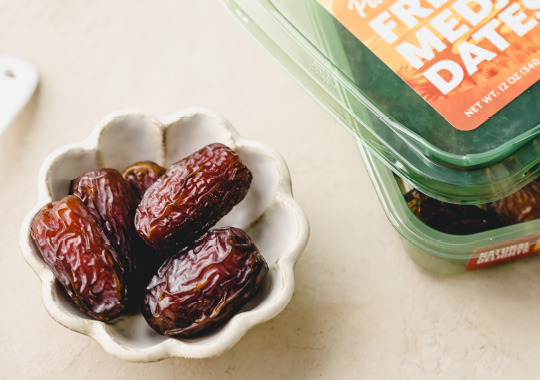 a small bowl of Natural Delights dates