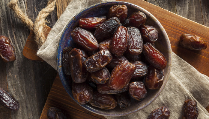bowl of dates on a cutting board