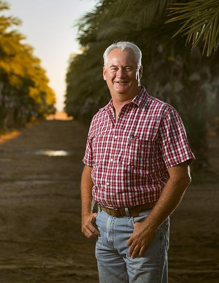Dave Mansheim in a date tree grove