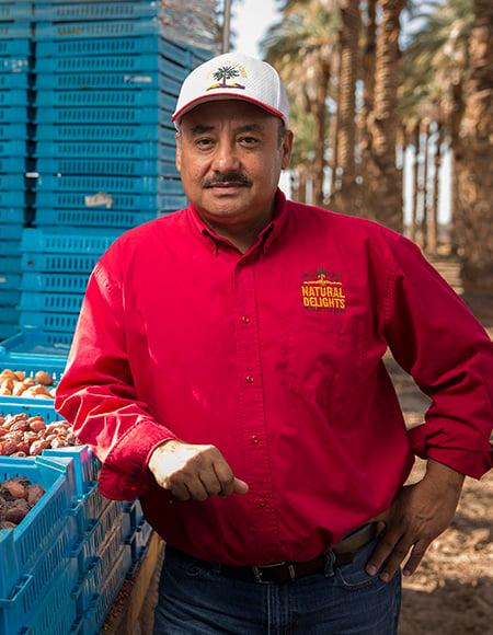 Gus Nunez working at a date farm